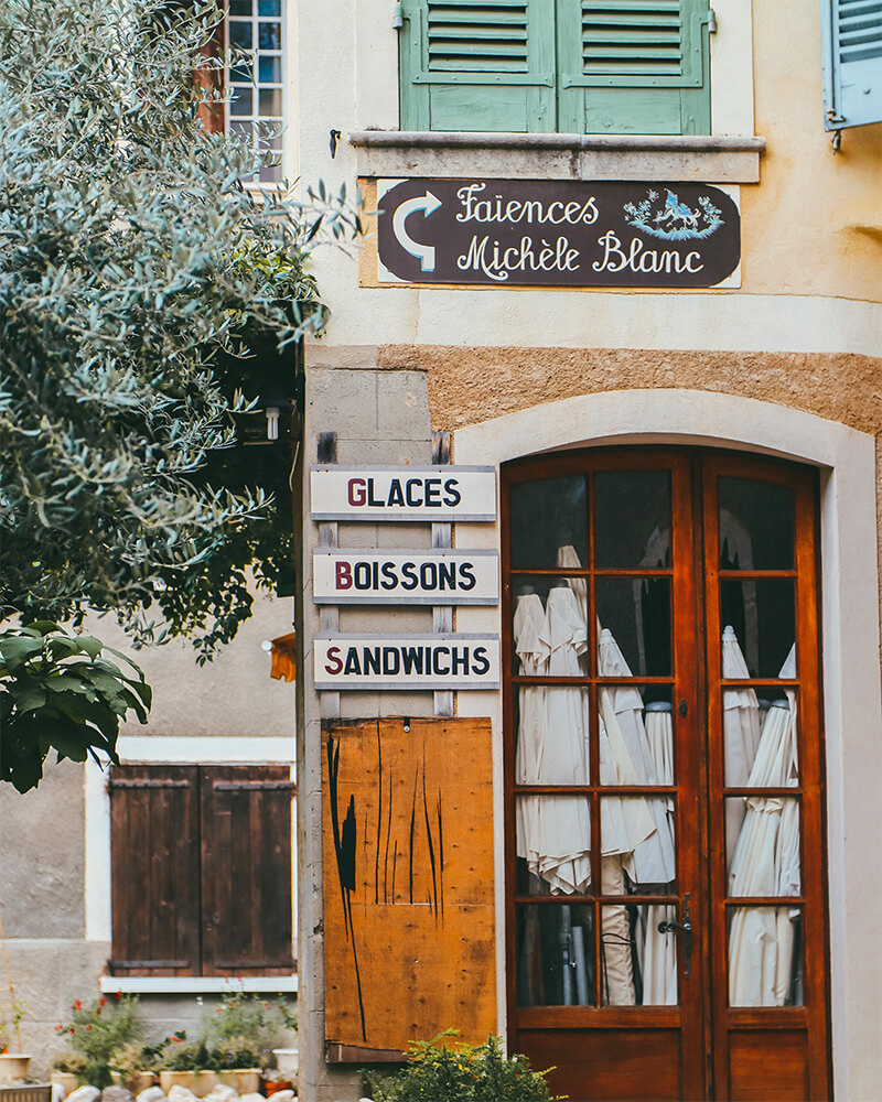 Shop front in a French village with writing on it