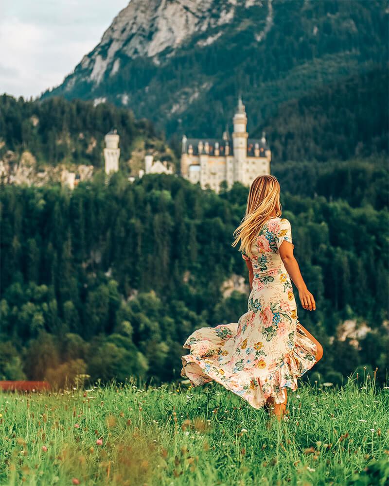 Me standing in front of Neuschwanstein castle in Germany, Bavaria