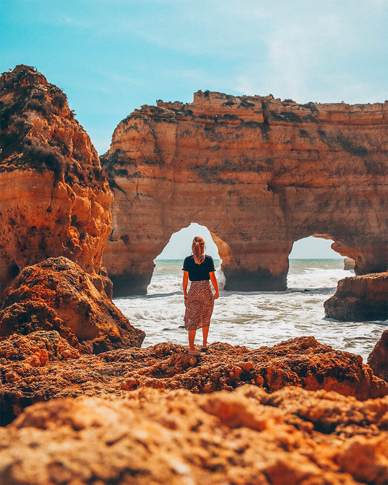 Me in front of the two natural arches at Praia Marinha
