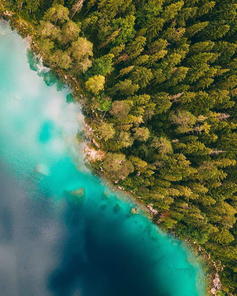 Eibsee lake from above taken with the drone with blue water and green trees