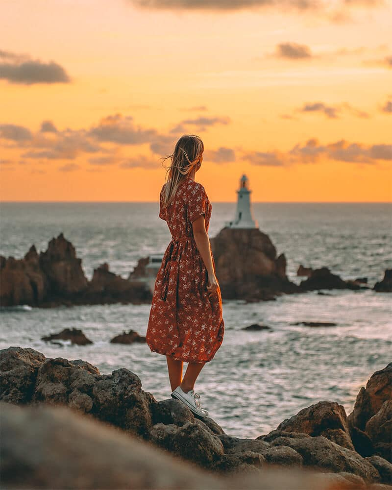 Me standing at Corbiere lighthouse at sunset