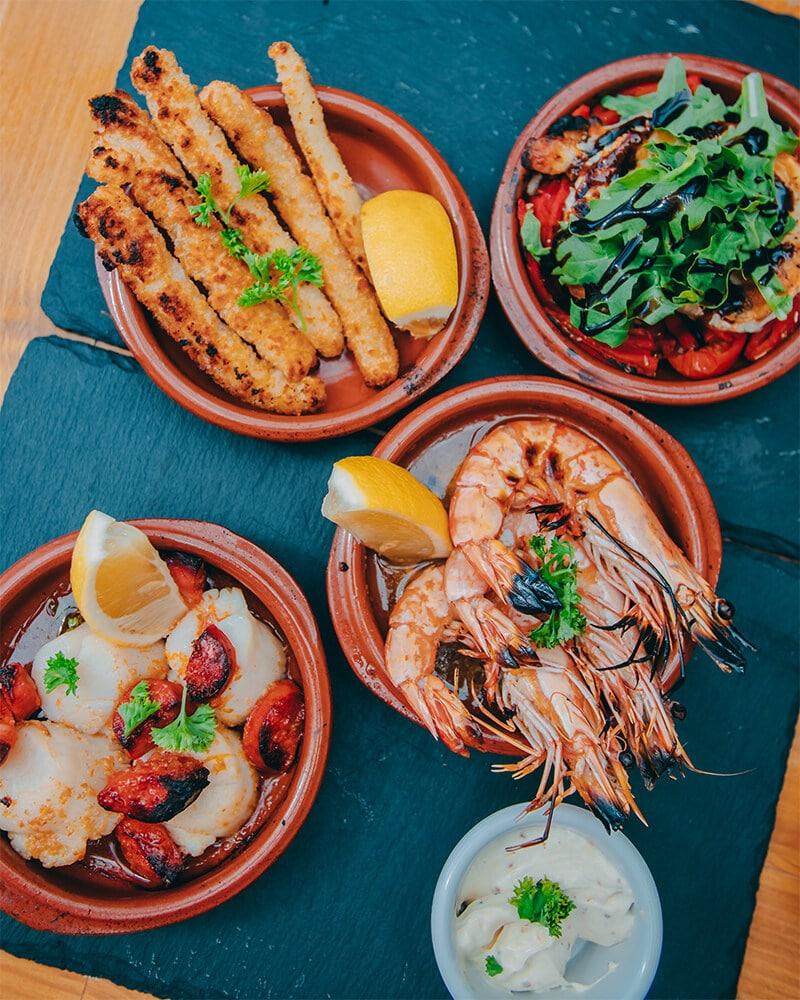 Tapas selection at Off the Rails, Jersey - calamari, prawns and scallops