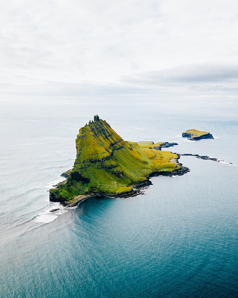 A small island in the sea at Vagar Island, Faroe Islands