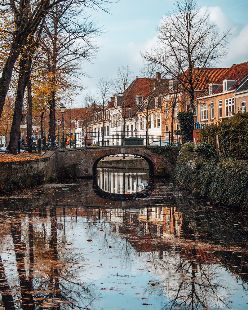 Best cities to visit in the Netherlands - Amersfoort canal with reflections and autumnal colours