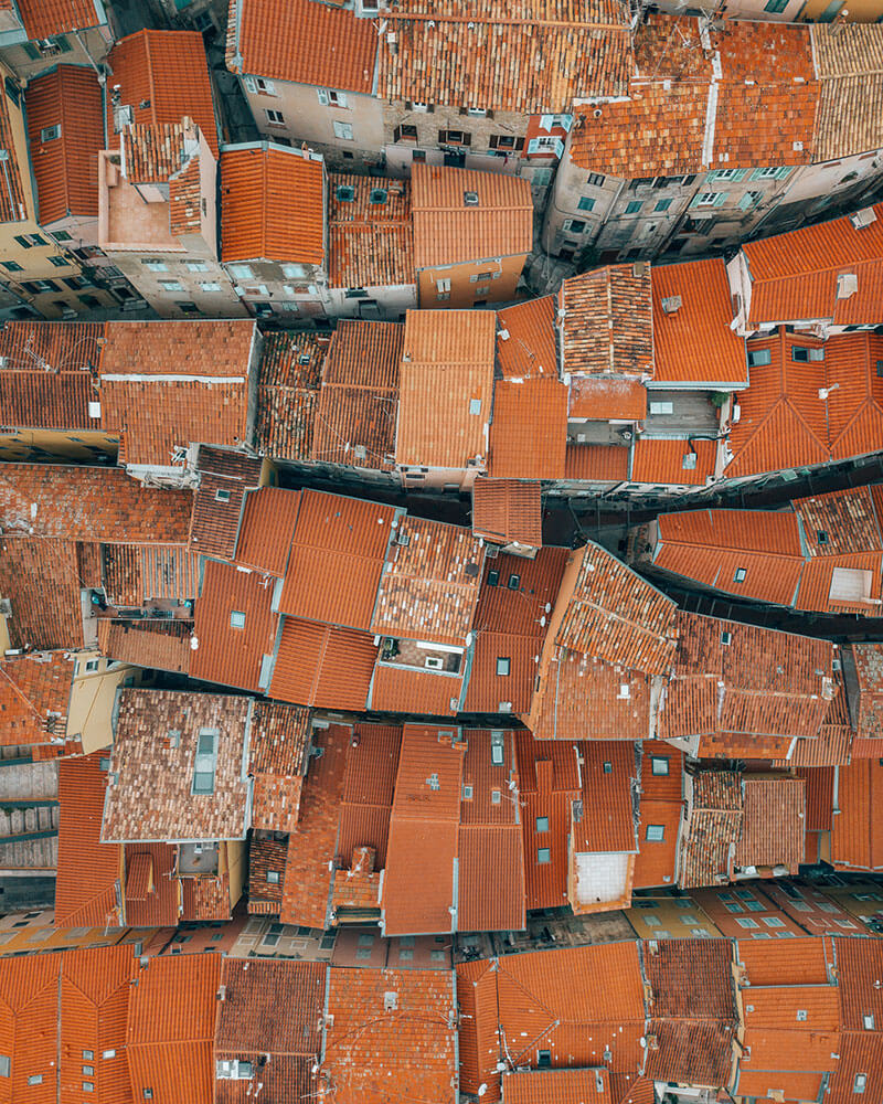 Top down drone shot of Menton orange rooftops in the French Riviera