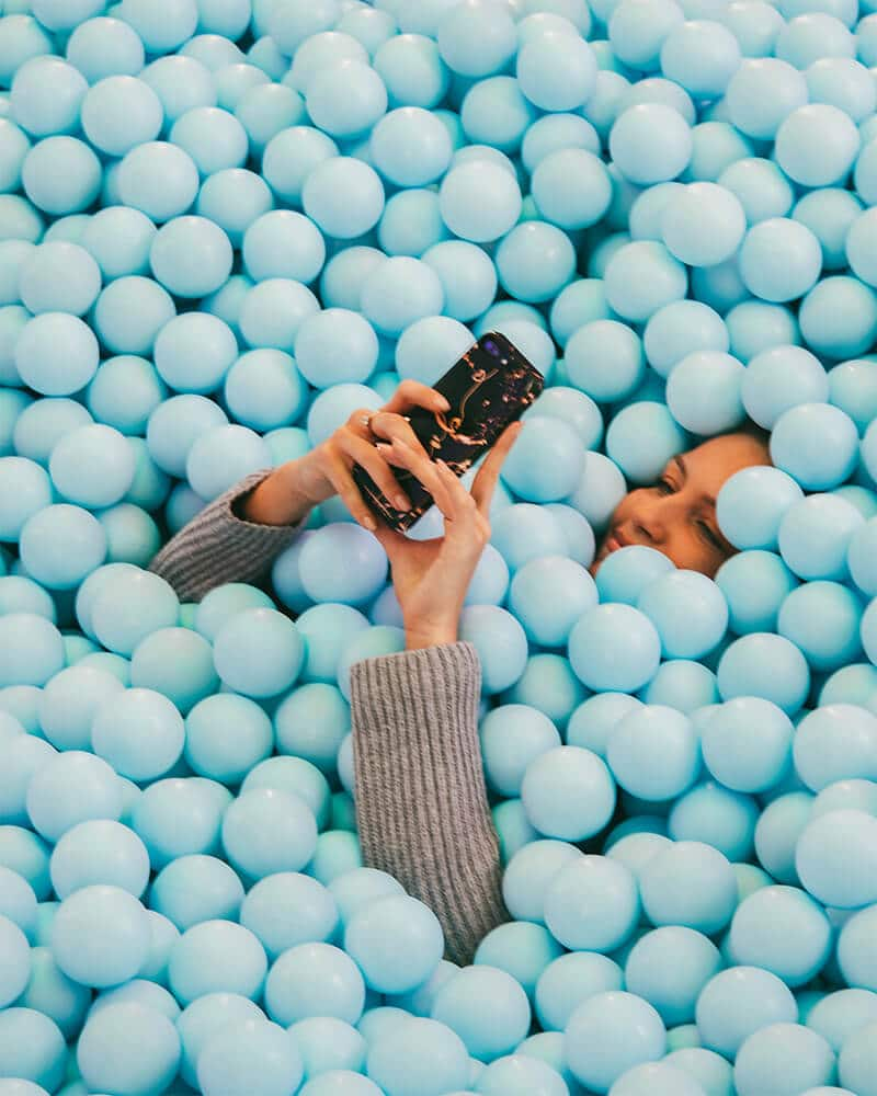 Girl in a ball pit at WONDR Experience Amsterdam!