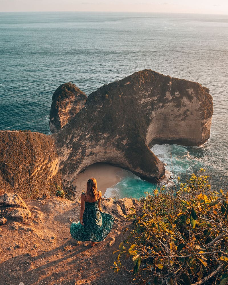 Girl stood over looking Kelingking Beach on Nusa Penida Island, Bali