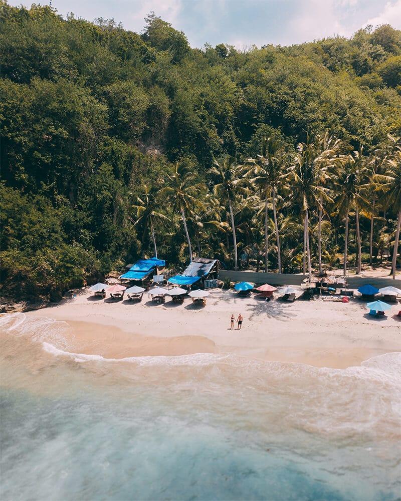 Drone shot of me and Boyan on Crystal Bay beach, Nusa Penida island