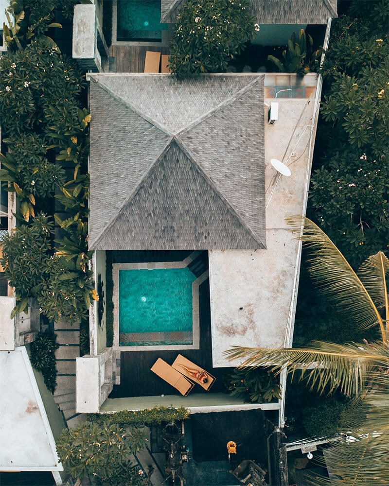 Drone shot of me sat i a private villa in Bali with a pool - unique places to stay in Ubud.