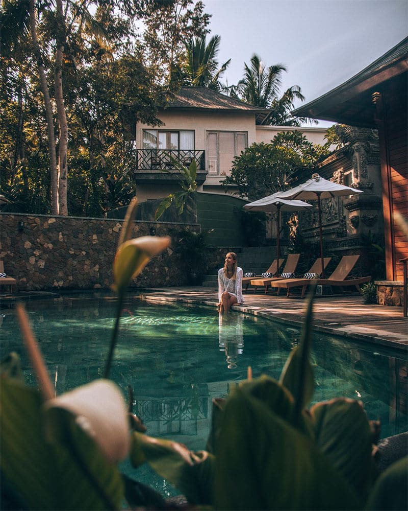 Me sat on the edge of a pool at an instagrammable hotel in Bali - Adiwana Arkara Villas in ubud, Bali