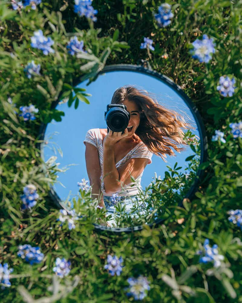 The Lovely Escapist with her outdoor mirror photoshoot among the flowers