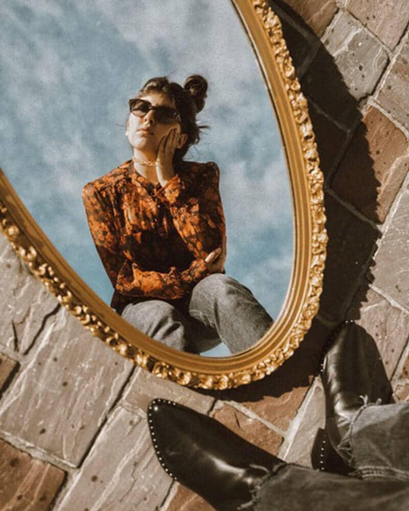 Aline Adjemian with her outdoor mirror photoshoot