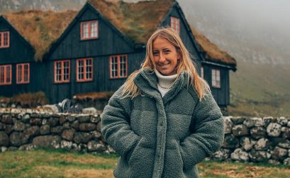 Me standing in front of a traditional Faroese house in Kirkjubour village in the Faroe Islands