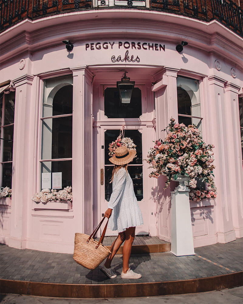 Girl in front of Peggy Porschen Cafe in London - most instagrammable places in London