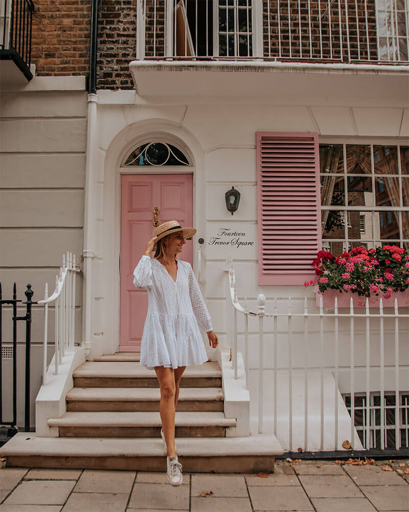 Girl stood in front of Fourteen Trevor Square in London