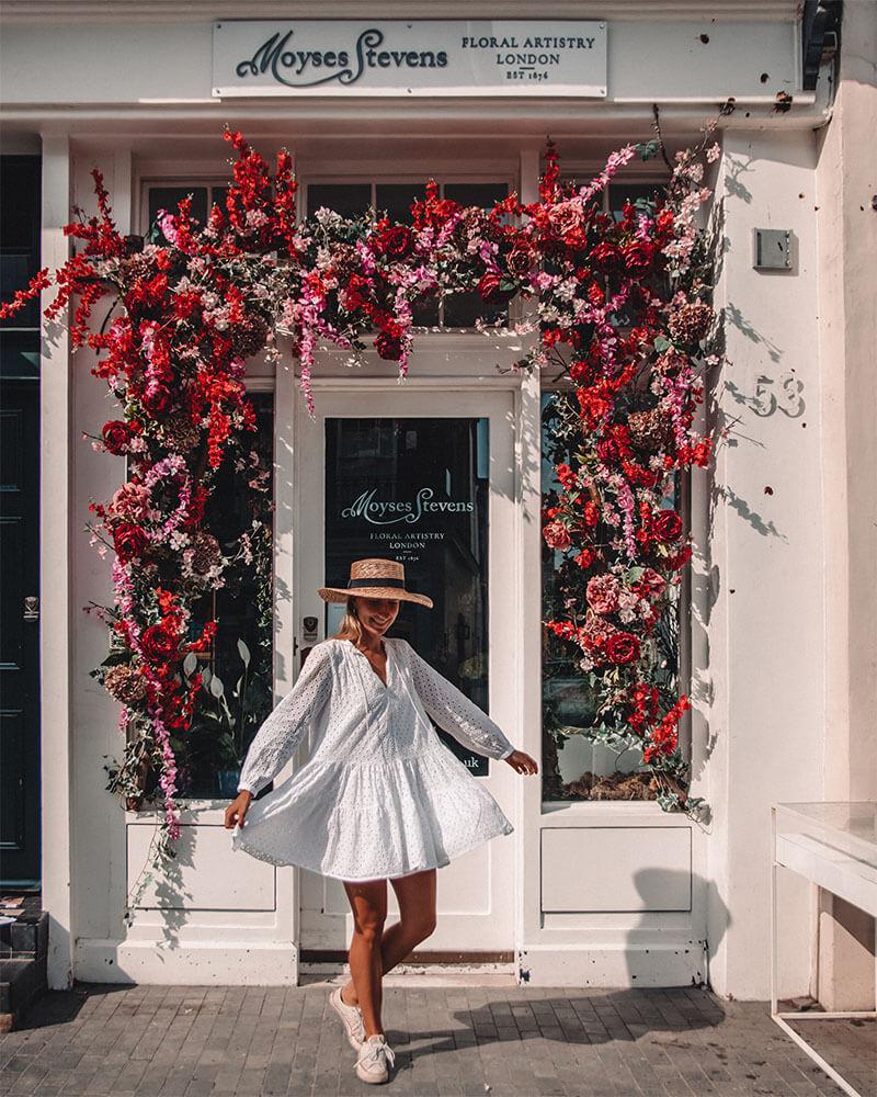 Girl twirling in front of Moyses Stevens in Belgravia in London
