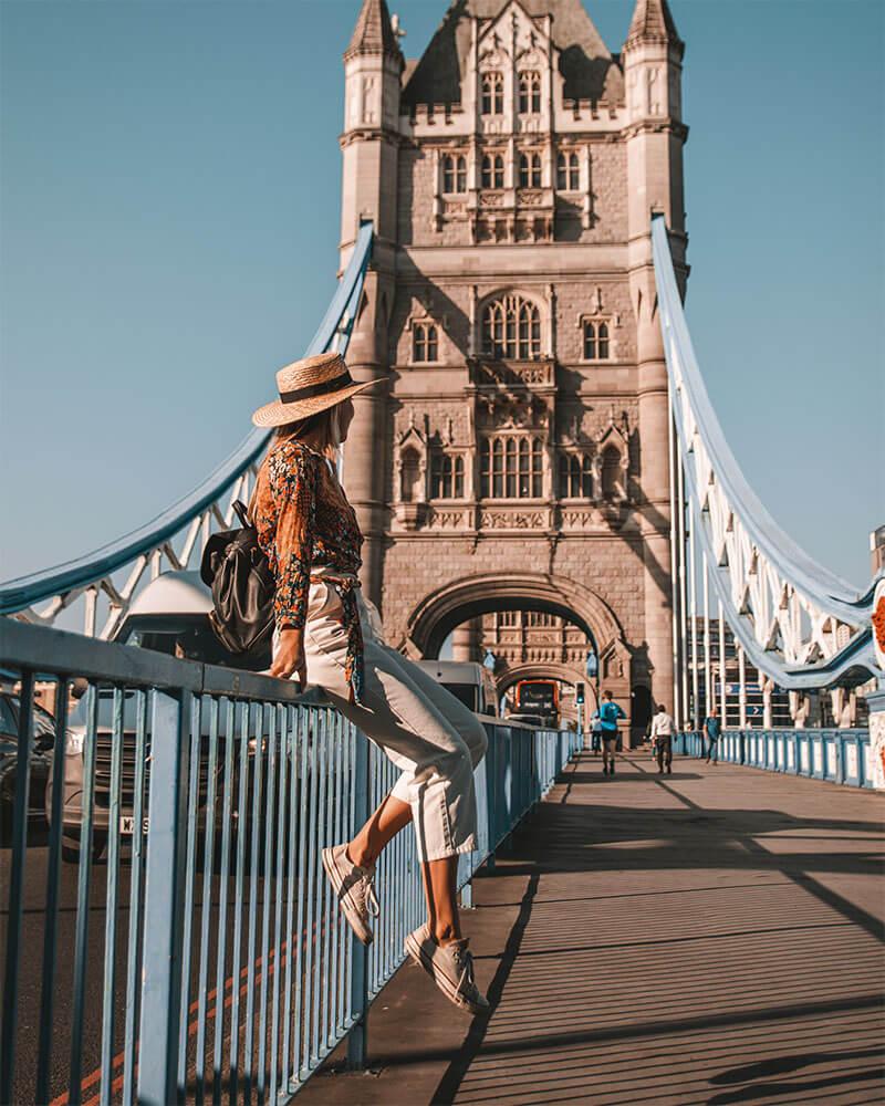 Girl sat on Tower Bridge in London