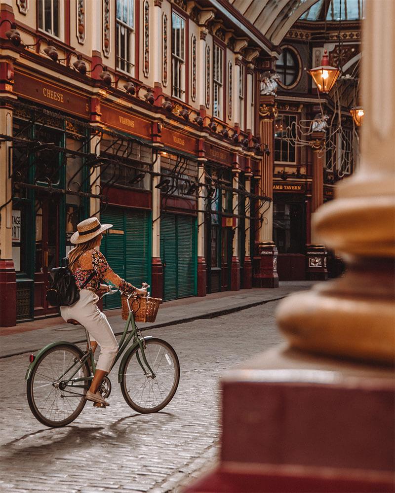 Girl cycling through Leadenhall Market