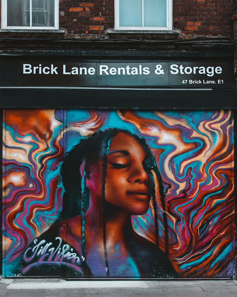 Brick Lane grafitti art of a womans face by Jim Vision
