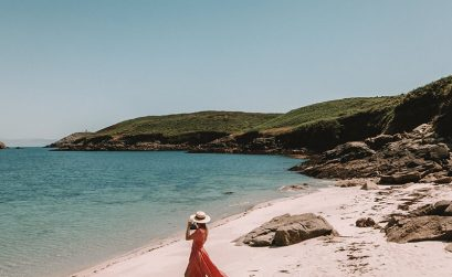 Drone shot of Solarpoweredblonde stood on the beach in St Martins Isles of Scilly in England