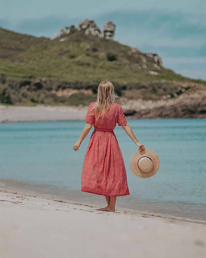 Solarpoweredblonde stood on the beach on St Martins Isles of Scilly