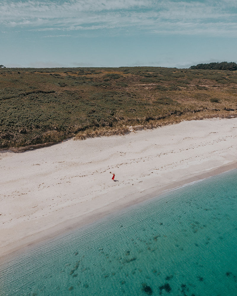 Drone shot of Solarpoweredblonde on Great Bay on St Martins Island Isles of Scilly Cornwall UK