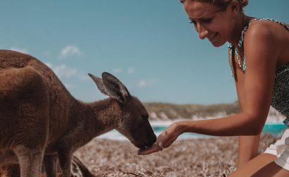 Solarpoweredblonde with a kangaroo on Lucky Bay in Esperance Western Australia