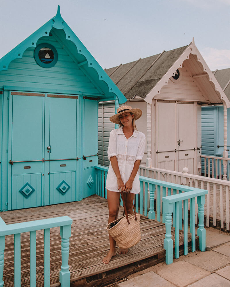 Solarpoweredblonde stood in front of a Mersea island beach hut