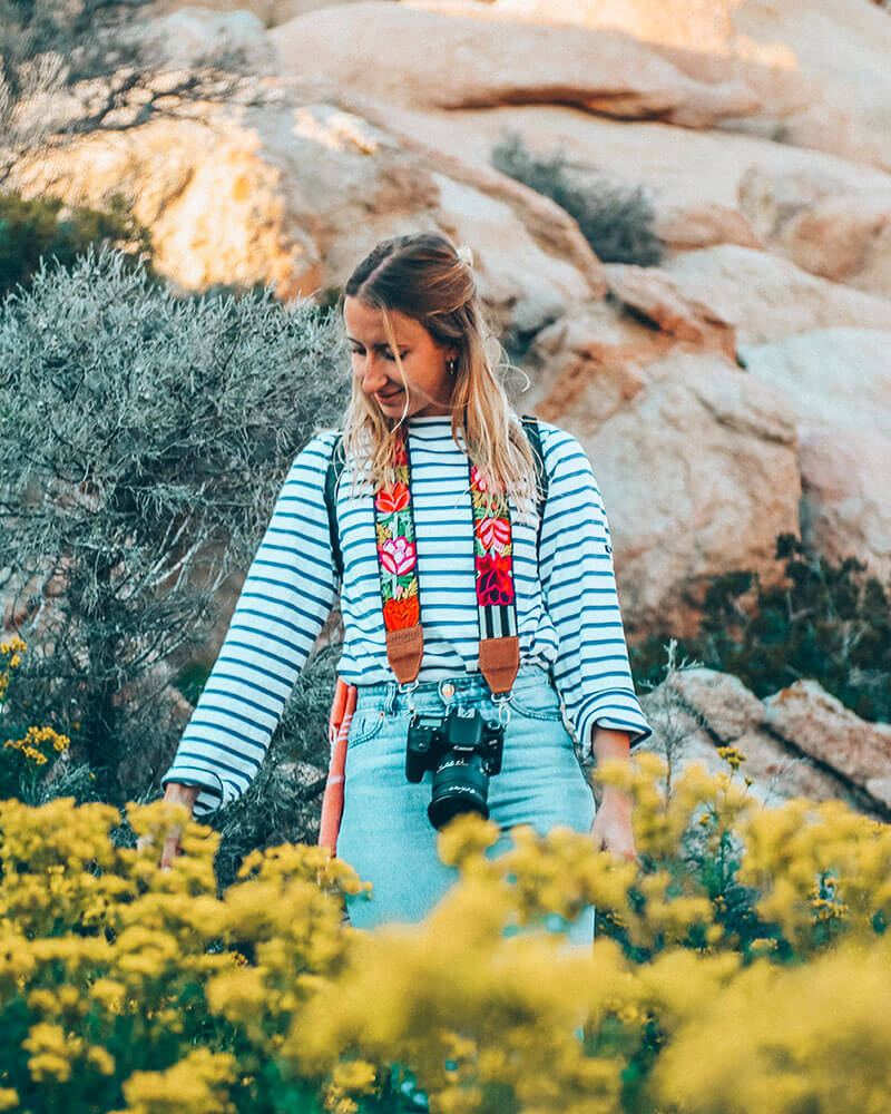 Solarpoweredblonde in Sardinia with a Hiptipico camera strap - the best camera for travel photography