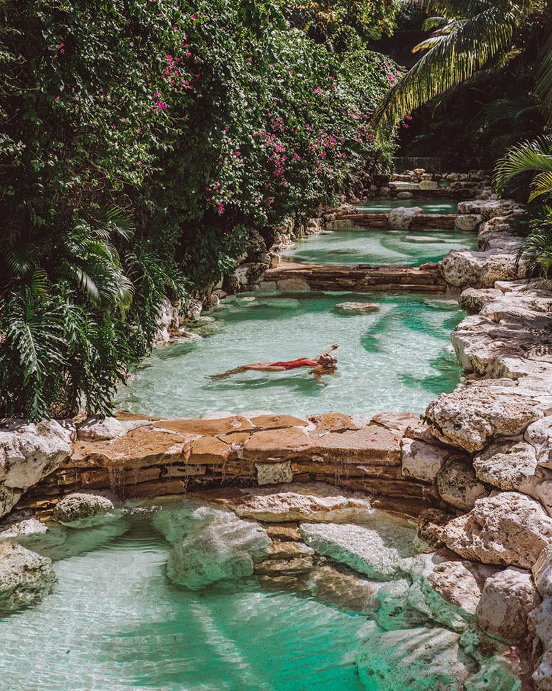 One Eighty Bali pool with girl lying in the pool