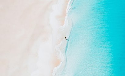 A beach in Aruba - drone shot of white sand and blue sea