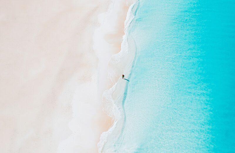 A beach in Aruba - drone shot of white sand and blue sea