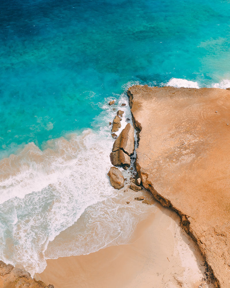 Drone shot of the sea and sand in Aruba