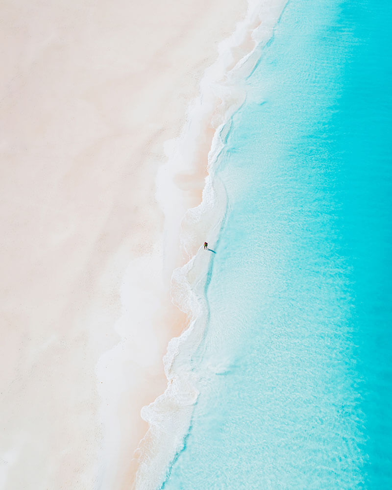Drone shot of a man on the beach in Aruba - best things to do in Aruba