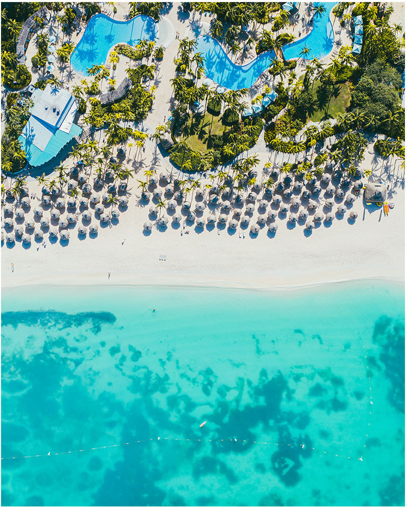 Drone shot of a hotel in Aruba with beach and sea