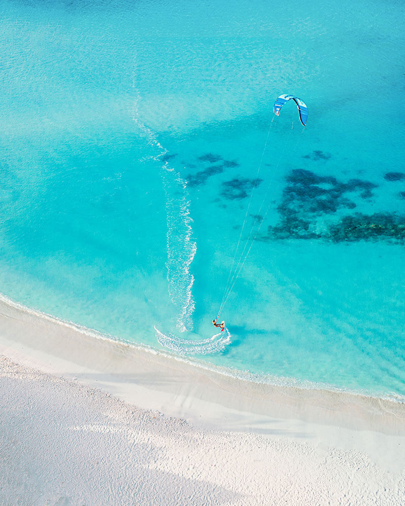Drone shot of a person kite surfing in Aruba