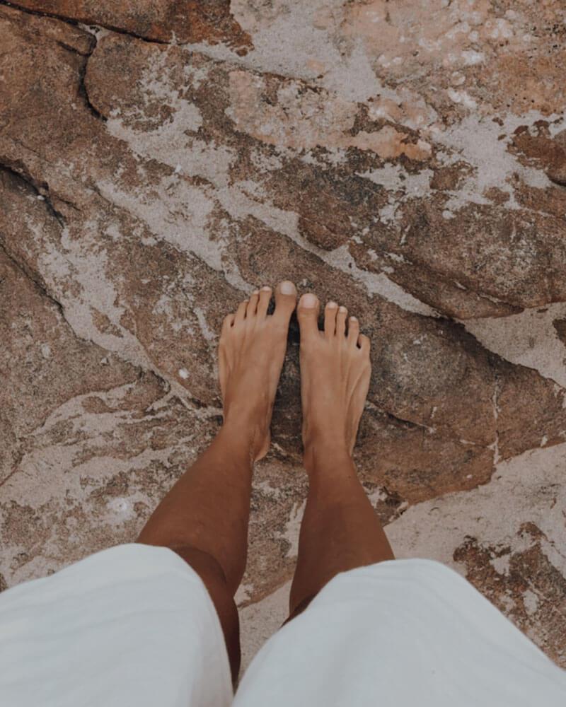 My feet on rocks at Indijup Natural Spa