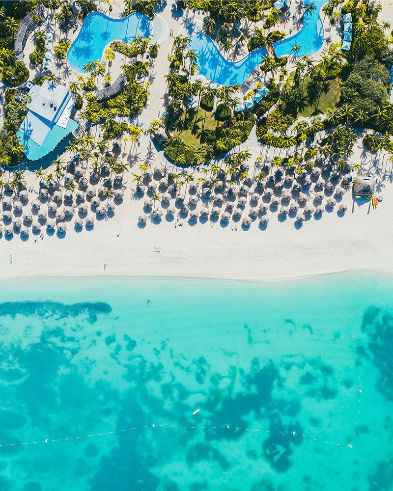 Drone shot of the Hilton Aruba beach at Palm Beach