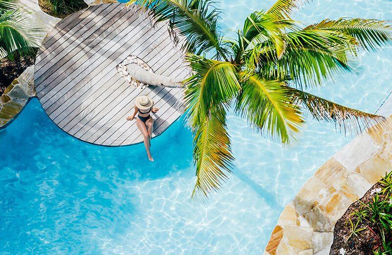 Girl sat at the pool at Boardwalk Hotel Aruba