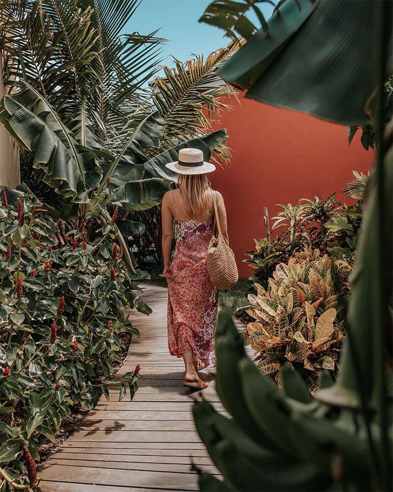 Girl walking through the trees at Boardwalk Boutique Hotel Aruba
